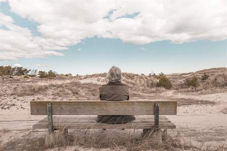 elderly woman on bench.jpg